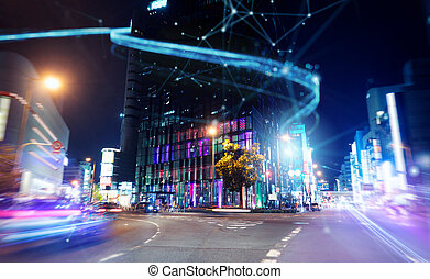 Fast connection in the city at night. Abstract technology background
