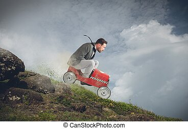 Fast downhill - Businessman playing with car and goes down
