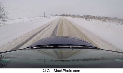 fast driving in a car on a country road in winter