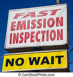 Fast Emission Inspection - Sign advertising fast emission...