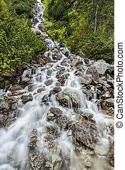 wild waterfall in high mlountains