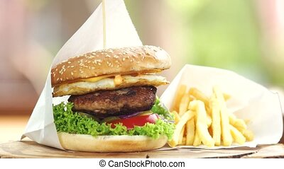 Fast food close up. Beef burger and french fries.