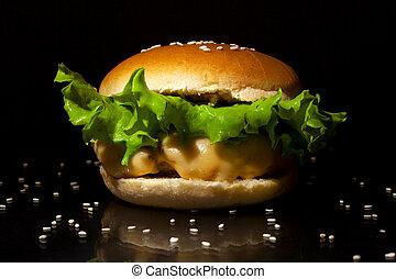 Fast food concept: fresh tasty burger on dark background