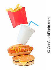 Fast food - Different types of fast food stacked on top of...