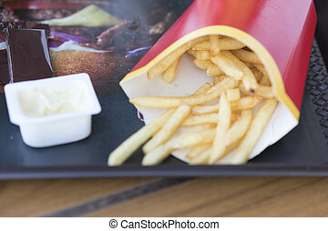 Fast food. French fries and sauce on a tray