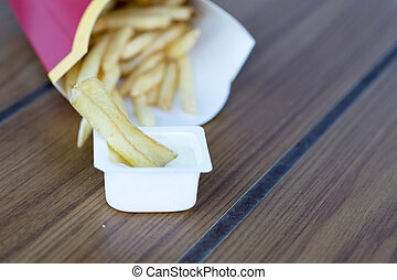 Fast food. French fries and sauce