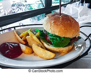 Fast food hamburger, potatoes, ketchup