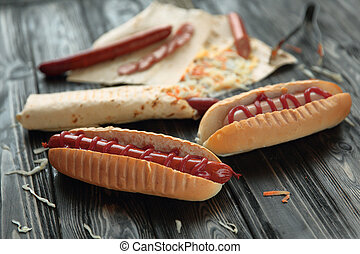 fast food. hot dogs and Shawarma on wooden background
