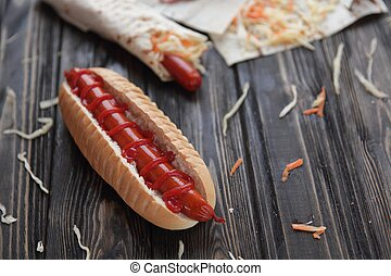 fast food. hot dogs with sauce on wooden background
