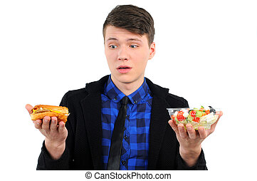 Fast food - isolated young man with burgers and salad