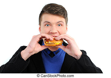 Fast food - Man eating a hamburger isolated on a white ...
