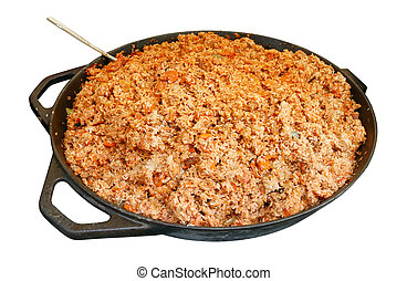 Fast food of the big city - metal  big frying pan with  red  hot fat pilaf.