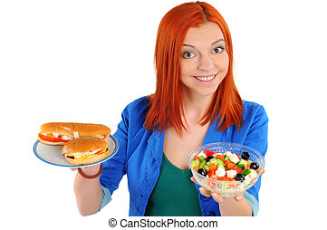 Fast food - Pretty young woman choice lettuce salad or fast...