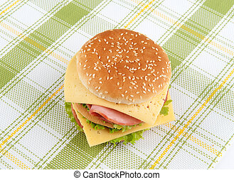 fast food sandwich with lettuce, ham and cheese