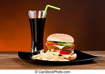 Fast food tasty hamburger  with franch fries and soda