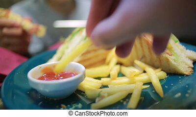 fast food, unhealthy eating, people and junk-food - close up of male hands with french fries