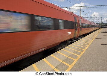 Fast going red train. Motion blur