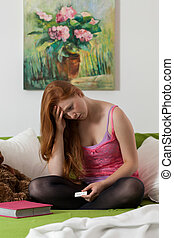 Fast growing up - Young girl sitting in her bedroom with...
