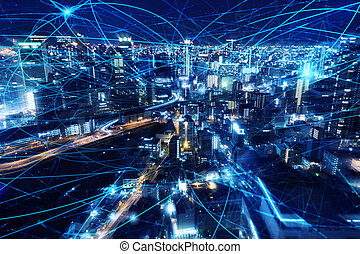 Fast internet connection in the city at night. Concept of technology and innovation