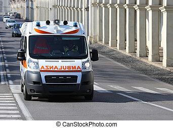 Italian ambulance runs to the city street