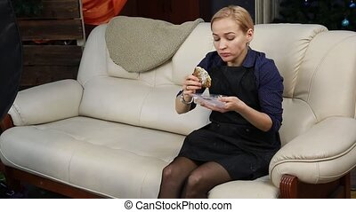 fast junk food at workplace. Blonde woman have a lunch from...