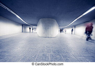 Fast life in the City with lot of Business People in underpass