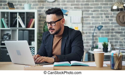 Fast motion of businessman drinking coffee working with...