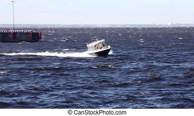 Fast motor boat in sea - speedboat, patrol boat in motion