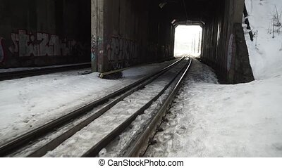 Fast moving camera to dark old railway tunnel. - Fast moving...
