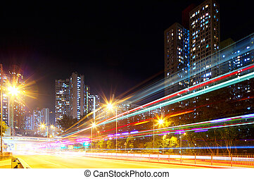 Fast moving car light in city