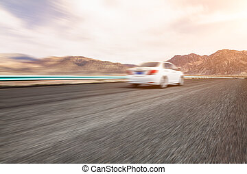 Fast moving car on the road