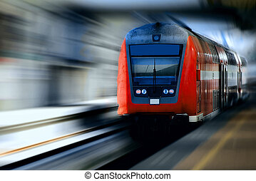 train - Fast moving red train against a blurred background.