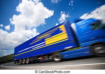 fast moving blue truck, motion blur. 16mpix