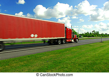 Fast moving truck with red container on highway, blurred because of fast motion