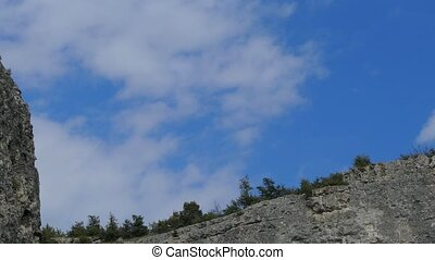 Fast-moving white clouds above the cliffs - Fast Moving...