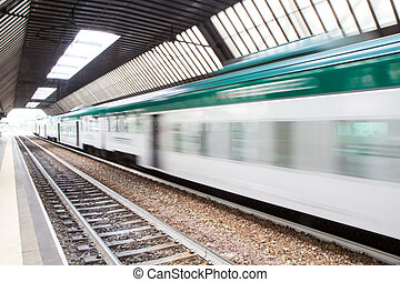 Fast Passenger Commuter Train with Motion Blur