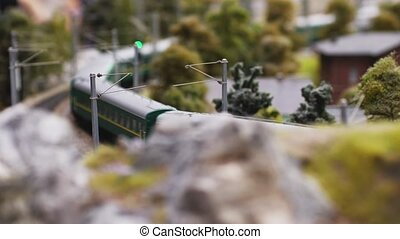 Fast passenger train in the countryside moving towards in...
