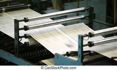 Fast process of black-and-white newspaper sheets passing the...
