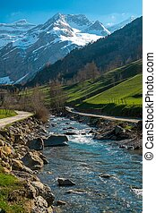 Fast river in valley with mountain view