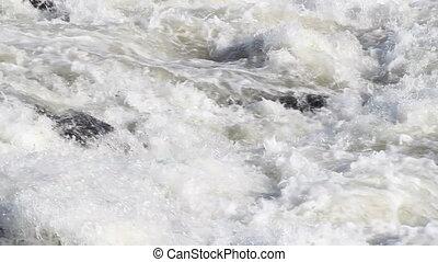 Fast running white water rapids.