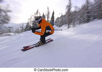 Fast Skiing - A skier tucks around a fast corner