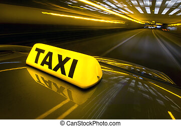 Fast taxi - A cab at high speed on a motorway in an urban...