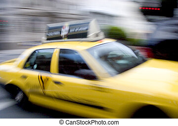 Fast Taxi - Shot of passing taxi is blurred to give the...