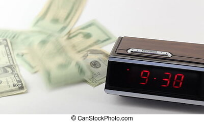 Fast Time Clock and Falling Money - A fast moving red...