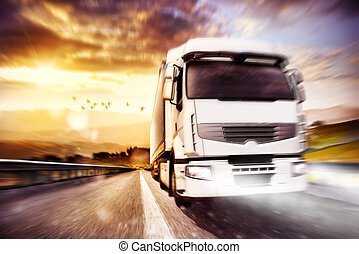 Fast transport truck. Mixed media - Truck on road in a...
