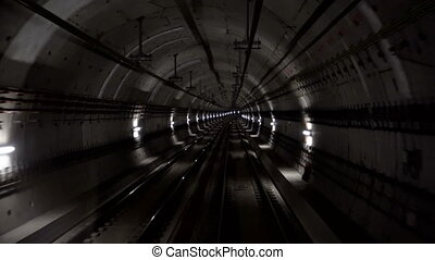 Fast underground train riding in a tunnel of the modern city
