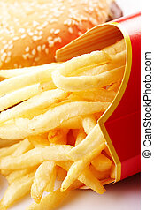 Fast Unhealthy Food - Burger and Fries in Cardboard Fast...