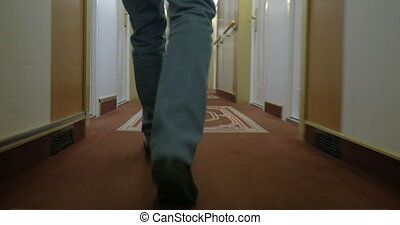 Fast Walking Man Along A Corridor Of Ocean Cruise Liner -...