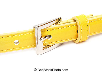 Fasten Belt - A fasten yellow belt buckle over white...