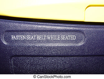 fasten seatbelt - sign in an airplane